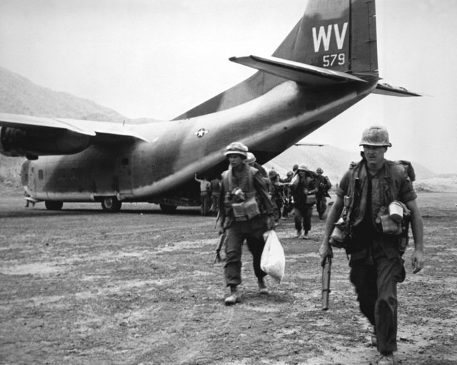 U.S. Marines head into combat after being airlifted to Calu by the C-123 Provider aircraft of the 311th Air Commando Squadron. In all, the 13 aircraft delivered 475 troops and over six tons of equipment in 90 minutes