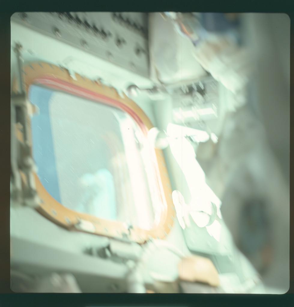 AS07-03-1514 - Apollo 7 - Apollo 7 Mission image, Command Module window, glare
