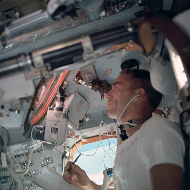 AS07-04-1559 - Apollo 7 - Apollo 7 Mission, Lunar Module Pilot Walter Cunningham inside Command Module