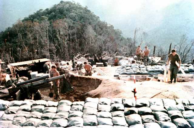 Members of the 3rd Marine Division complete construction of M101 105 mm howitzer positions at a mountain-top fire support base