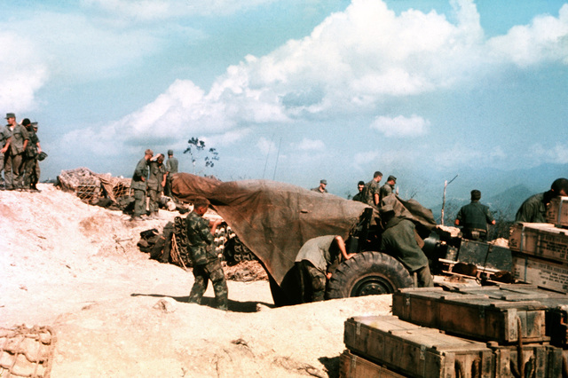 Members of the 3rd Marine Division set up a howitzer during construction of a mountain-top fire support base