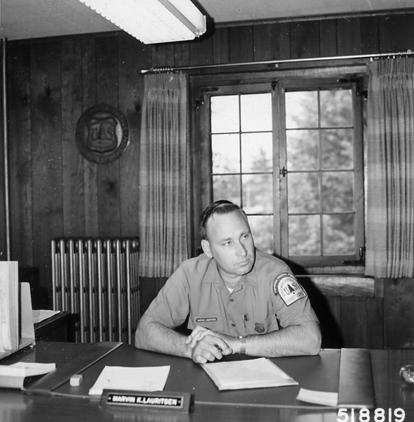 Photograph of Forest Supervisor Listening to a Problem Before Making a Decision
