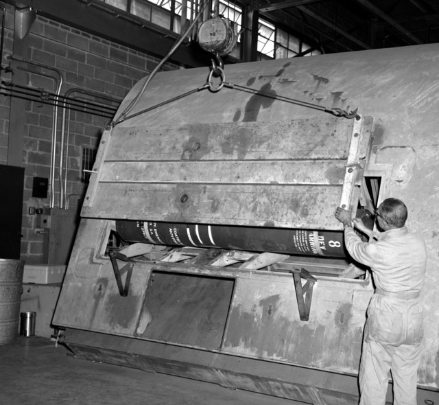 A simulated submarine hull section is secured following the loading of a submarine emergency communication transmitter (SECT) buoy Mark 9 Mod O during testing at the Naval Ordnance Laboratory. When put into fleet use the SECT, which will ride outside the submarine's pressure hull and inside the submarine's outer hull, will be released an act as a surface marker if and when the ship is sunk