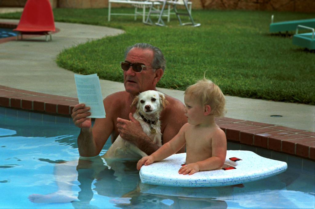 President Lyndon B. Johnson on his Birthday in Swimming Pool with his Dog and Grandson