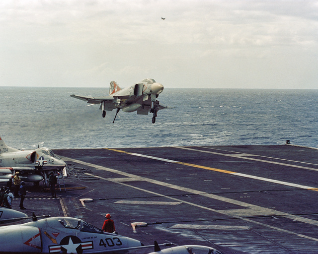 An F-4 Phantom II aircraft approaches for a landing aboard the attack aircraft carrier USS JOHN F. KENNEDY (CV 67)