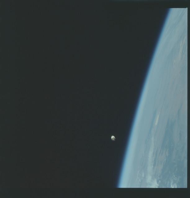 AS09-19-2951 - Apollo 9 - Apollo 9 Mission image - Earth limb with S.L.A. in distance