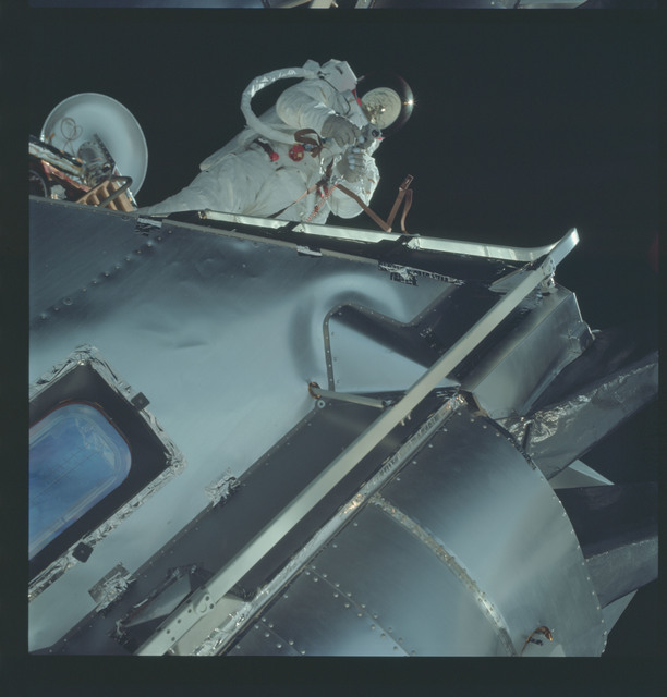 AS09-19-2984 - Apollo 9 - Apollo 9 Mission image - Astronaut Russell L. Schweickart, lunar module pilot, during EVA