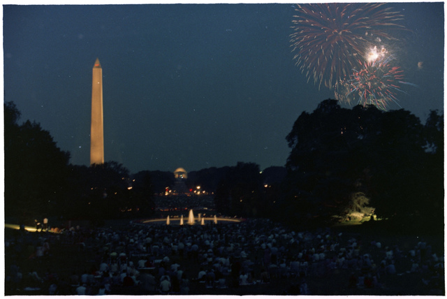A Large Audience of White House Staff Members Watch Fourth of July Fireworks from the Grounds at the White House, the Washington Monument and Jefferson Memorial are Visible in the Background
