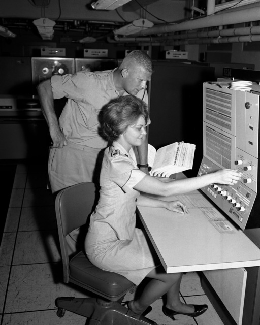 Captain P.S. Waters is briefed by Lieutenant Peterson as he tours the Computer Science School at the Data Processing Installation