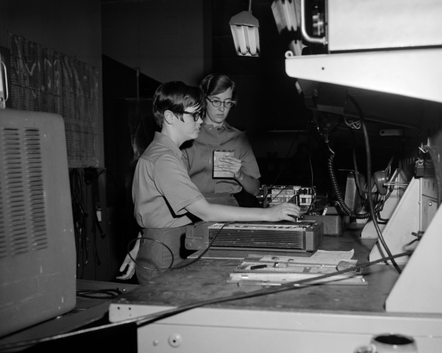 Female Marine work with testing equipment at the Electronic Support Branch