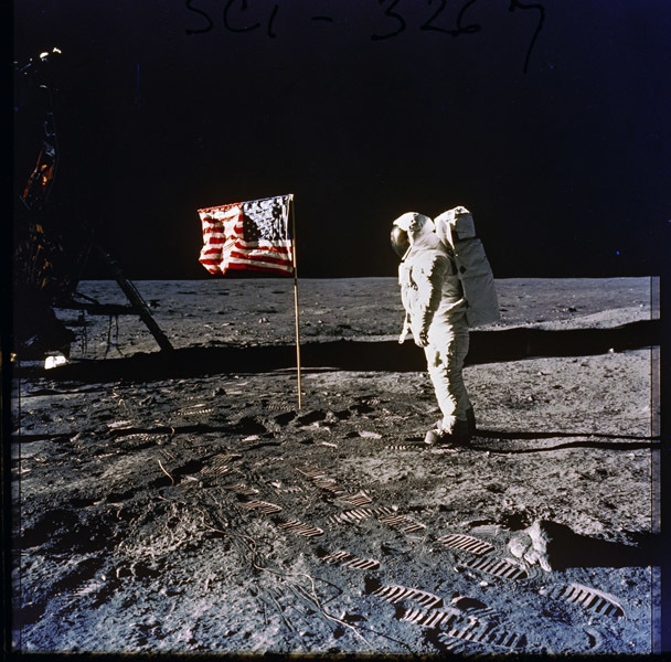 Photograph of Astronaut Edwin E. (Buzz) Aldrin, Jr. Posing on the Moon Next to the U.S. Flag