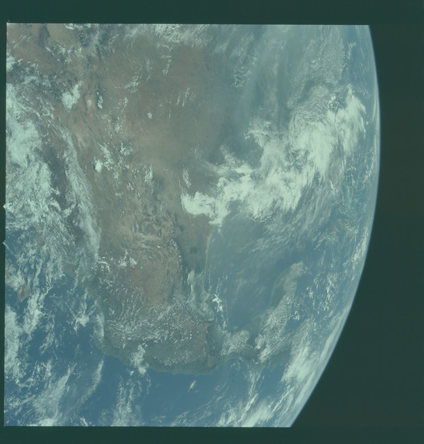AS11-36-5305 - Apollo 11 - Apollo 11 Mission image - Earth limb with United States and Mexico visible