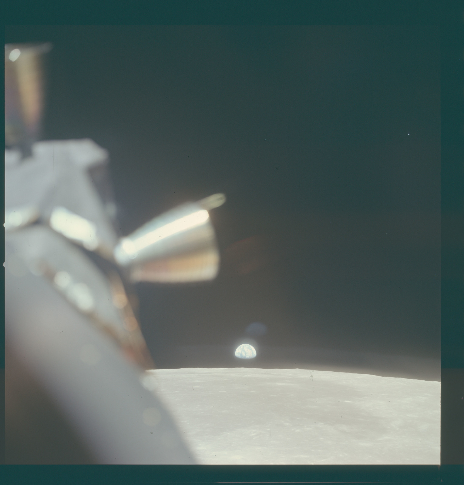 AS11-37-5439 - Apollo 11 - Apollo 11 Mission image - View of Moon, with Earth visible over the horizon