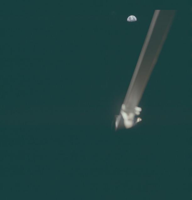 AS11-37-5506 - Apollo 11 - Apollo 11 Mission image - Lunar Module strut and Earth view.