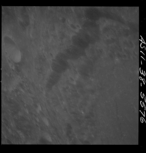 AS11-38-5576 - Apollo 11 - Apollo 11 Mission image - View of Moon, west rim of Crater 297