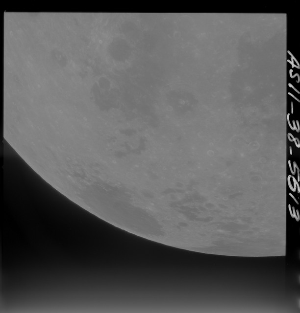 AS11-38-5613 - Apollo 11 - Apollo 11 Mission image - Partial view of Moon after Transearth Insertion