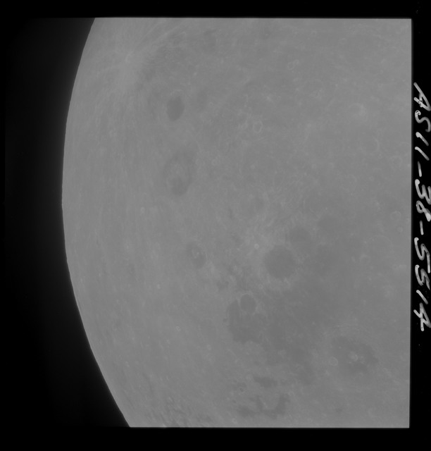 AS11-38-5614 - Apollo 11 - Apollo 11 Mission image - Partial view of Moon after Transearth Insertion