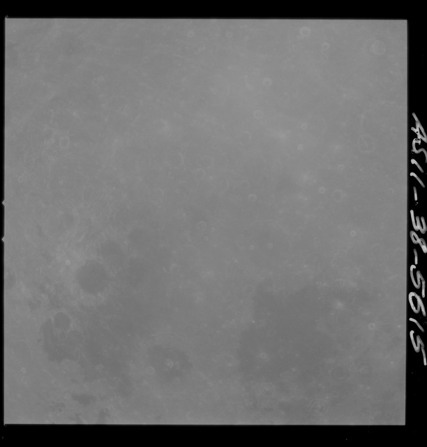 AS11-38-5615 - Apollo 11 - Apollo 11 Mission image - Partial view of Moon after Transearth Insertion