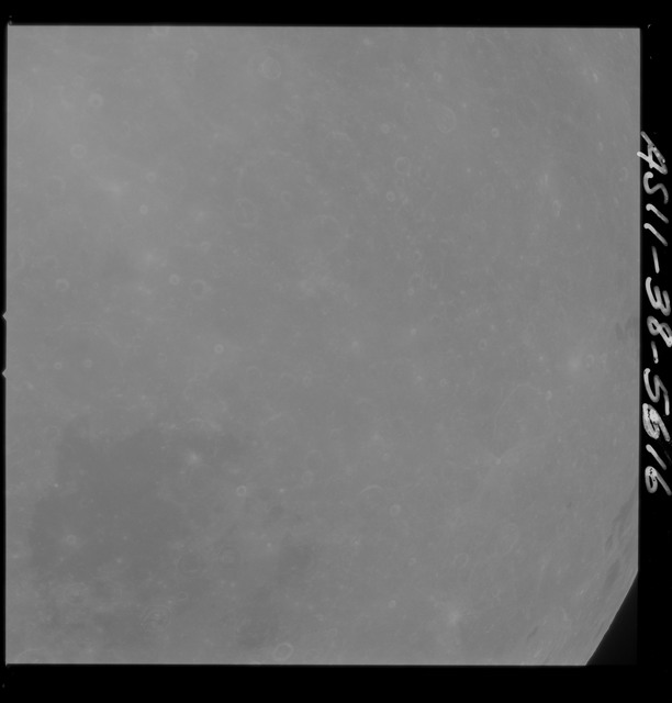 AS11-38-5616 - Apollo 11 - Apollo 11 Mission image - Partial view of Moon after Transearth Insertion