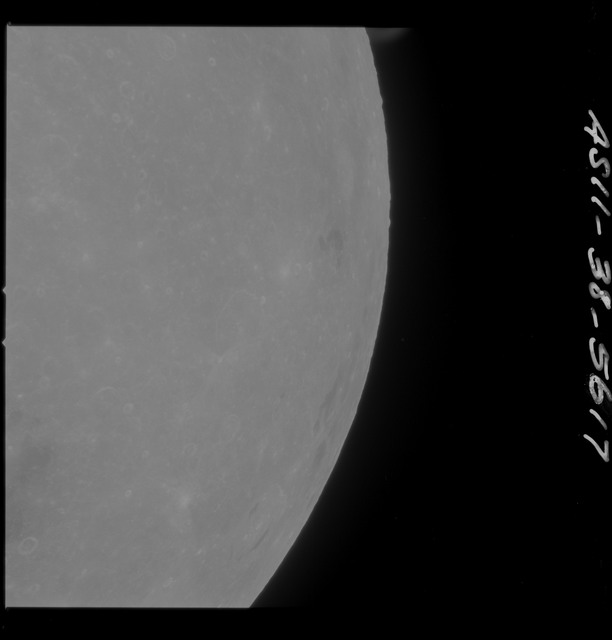 AS11-38-5617 - Apollo 11 - Apollo 11 Mission image - Partial view of Moon after Transearth Insertion
