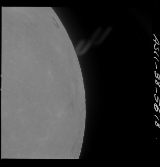 AS11-38-5618 - Apollo 11 - Apollo 11 Mission image - Partial view of Moon after Transearth Insertion