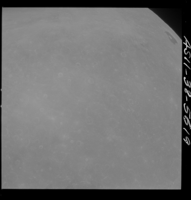 AS11-38-5619 - Apollo 11 - Apollo 11 Mission image - Partial view of Moon after Transearth Insertion