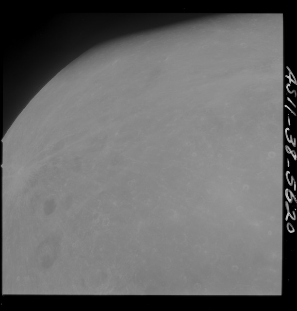 AS11-38-5620 - Apollo 11 - Apollo 11 Mission image - Partial view of Moon after Transearth Insertion