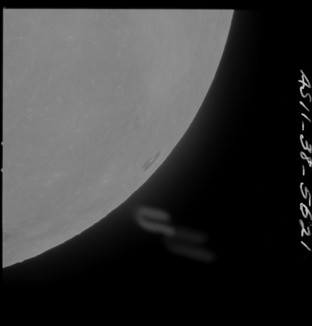 AS11-38-5621 - Apollo 11 - Apollo 11 Mission image - Partial view of Moon after Transearth Insertion