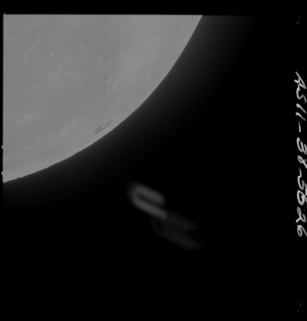 AS11-38-5626 - Apollo 11 - Apollo 11 Mission image - Partial view of Moon after Transearth Insertion
