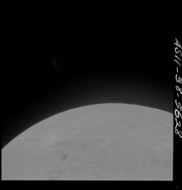 AS11-38-5628 - Apollo 11 - Apollo 11 Mission image - Partial view of Moon after Transearth Insertion