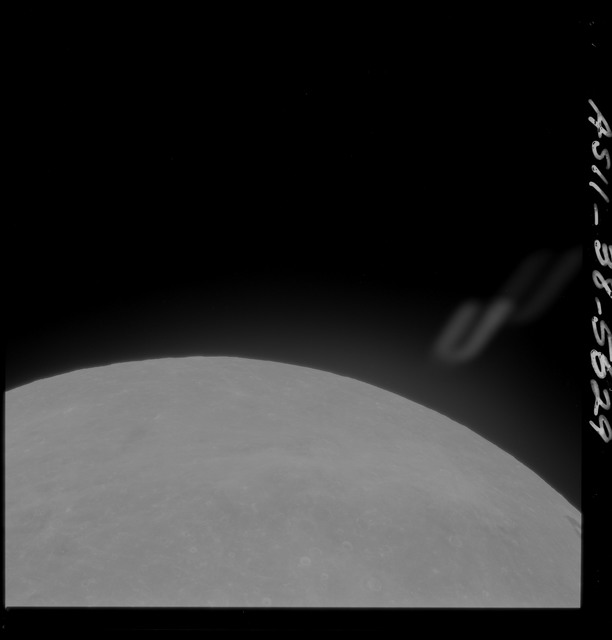 AS11-38-5629 - Apollo 11 - Apollo 11 Mission image - Partial view of Moon after Transearth Insertion