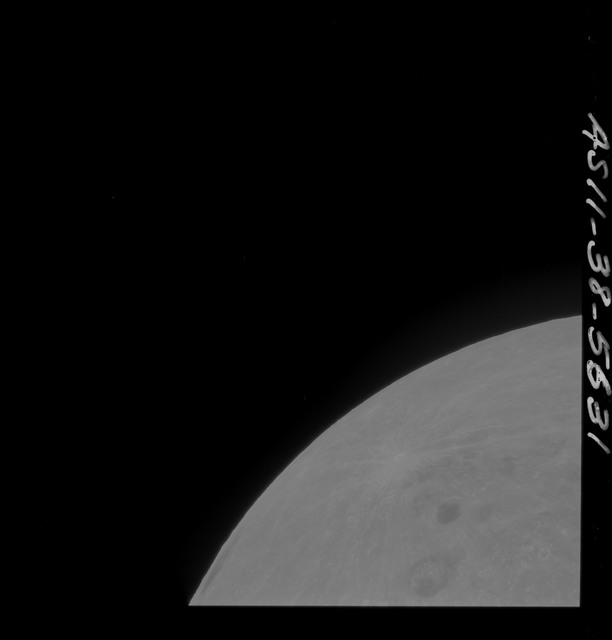 AS11-38-5631 - Apollo 11 - Apollo 11 Mission image - Partial view of Moon after Transearth Insertion