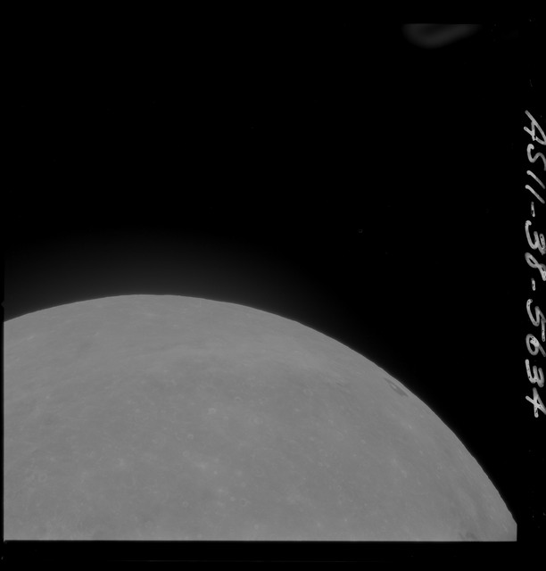 AS11-38-5634 - Apollo 11 - Apollo 11 Mission image - Partial view of Moon after Transearth Insertion