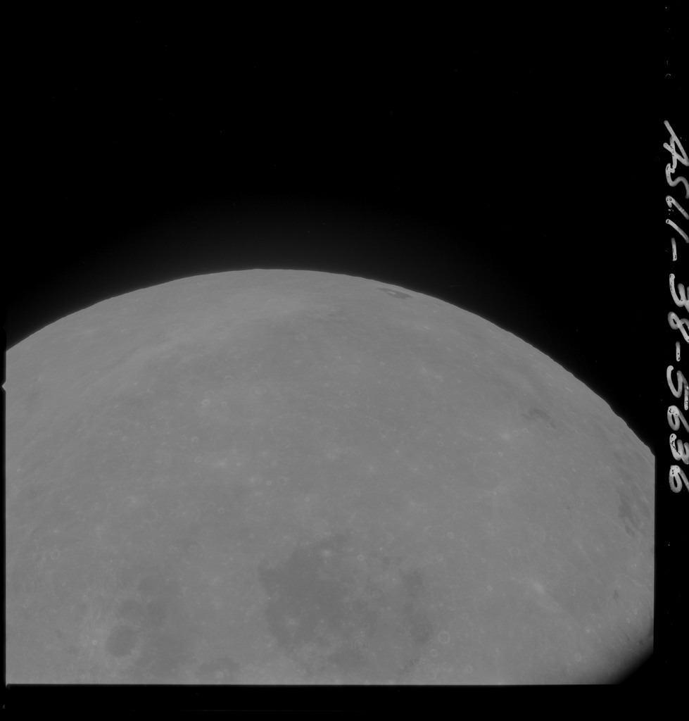 AS11-38-5636 - Apollo 11 - Apollo 11 Mission image - Partial view of Moon after Transearth Insertion