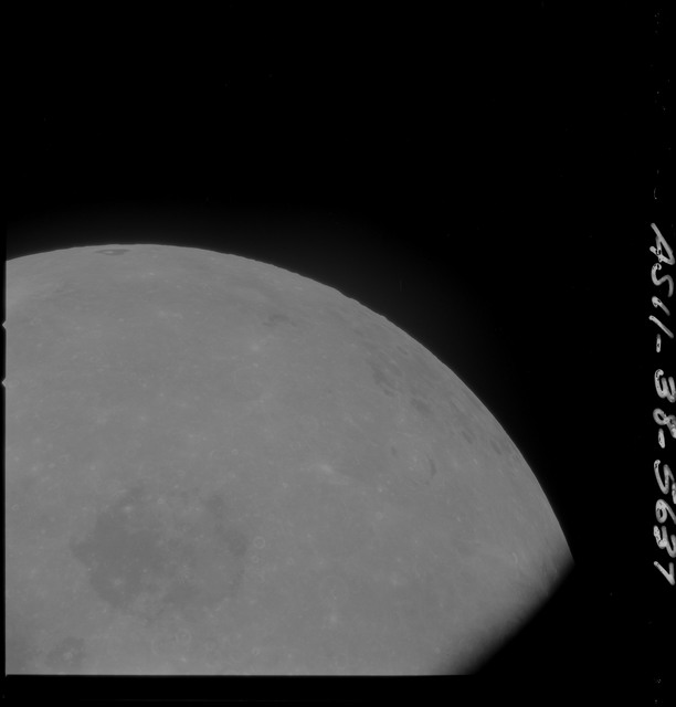 AS11-38-5637 - Apollo 11 - Apollo 11 Mission image - Partial view of Moon after Transearth Insertion