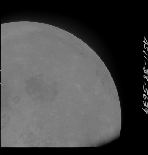 AS11-38-5639 - Apollo 11 - Apollo 11 Mission image - Partial view of Moon after Transearth Insertion