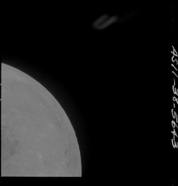 AS11-38-5643 - Apollo 11 - Apollo 11 Mission image - Partial view of Moon after Transearth Insertion