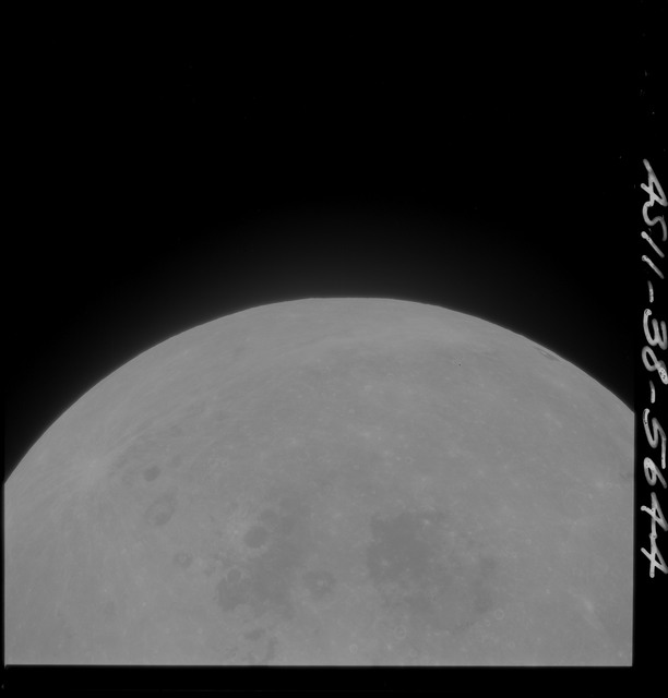 AS11-38-5644 - Apollo 11 - Apollo 11 Mission image - Partial view of Moon after Transearth Insertion