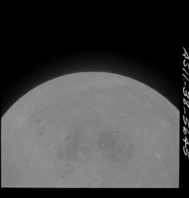 AS11-38-5645 - Apollo 11 - Apollo 11 Mission image - Partial view of Moon after Transearth Insertion