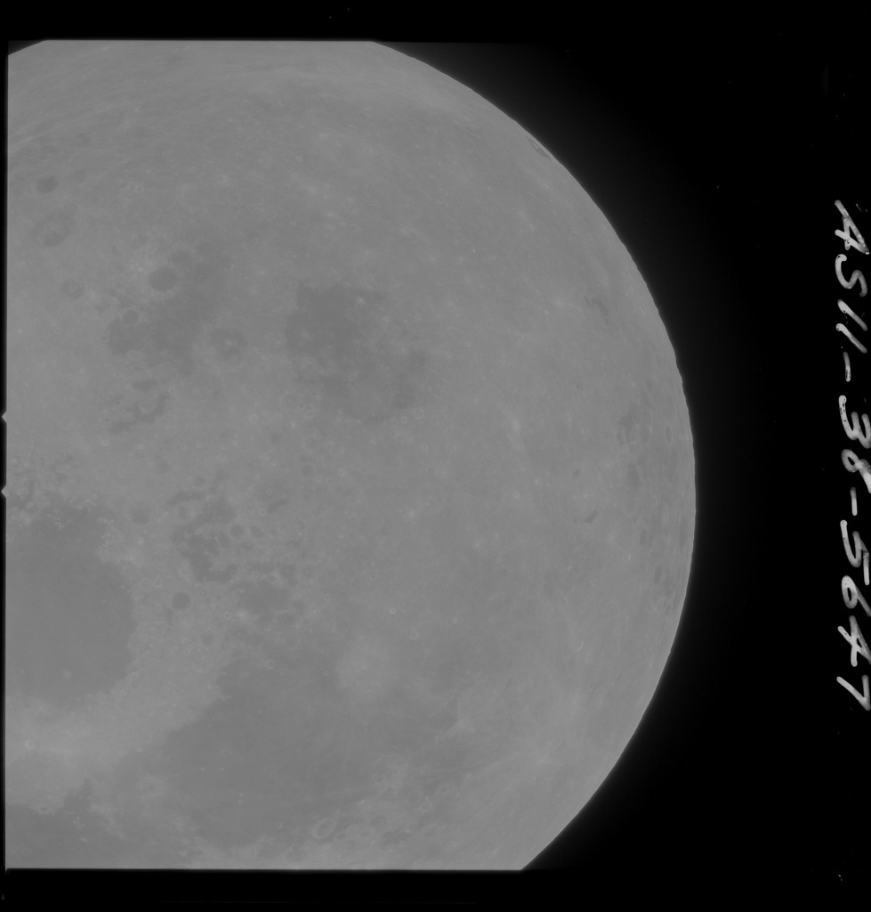AS11-38-5647 - Apollo 11 - Apollo 11 Mission image - Partial view of Moon after Transearth Insertion