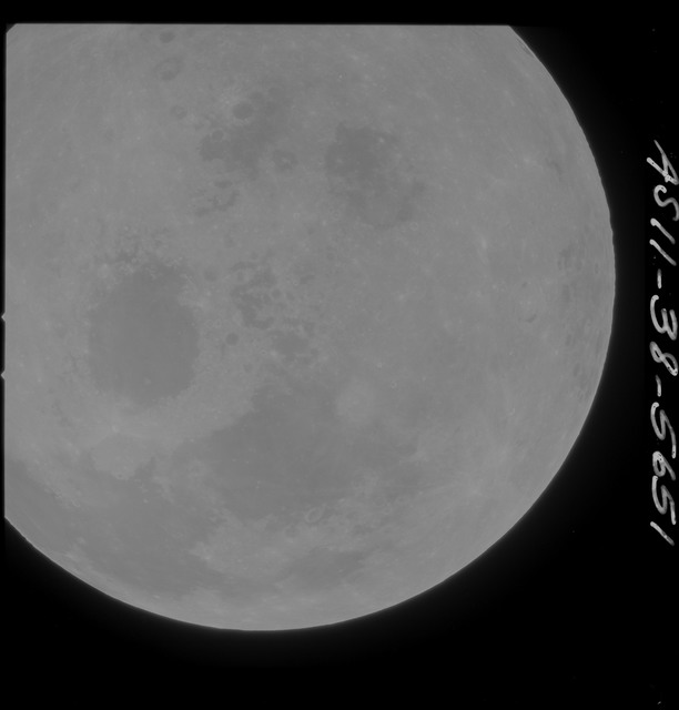AS11-38-5651 - Apollo 11 - Apollo 11 Mission image - Partial view of Moon after Transearth Insertion