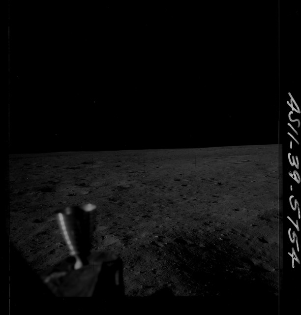 AS11-39-5754 - Apollo 11 - Apollo 11 Mission image - Lunar module thruster and lunar surface