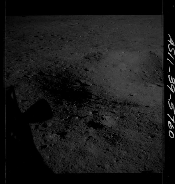 AS11-39-5760 - Apollo 11 - Apollo 11 Mission image - Lunar Module thruster shadow and lunar surface