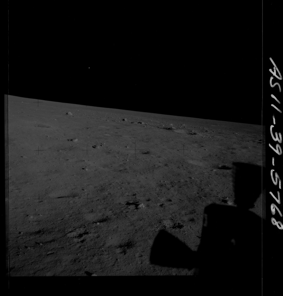 AS11-39-5768 - Apollo 11 - Apollo 11 Mission image - Shadow of LM thruster on lunar surface