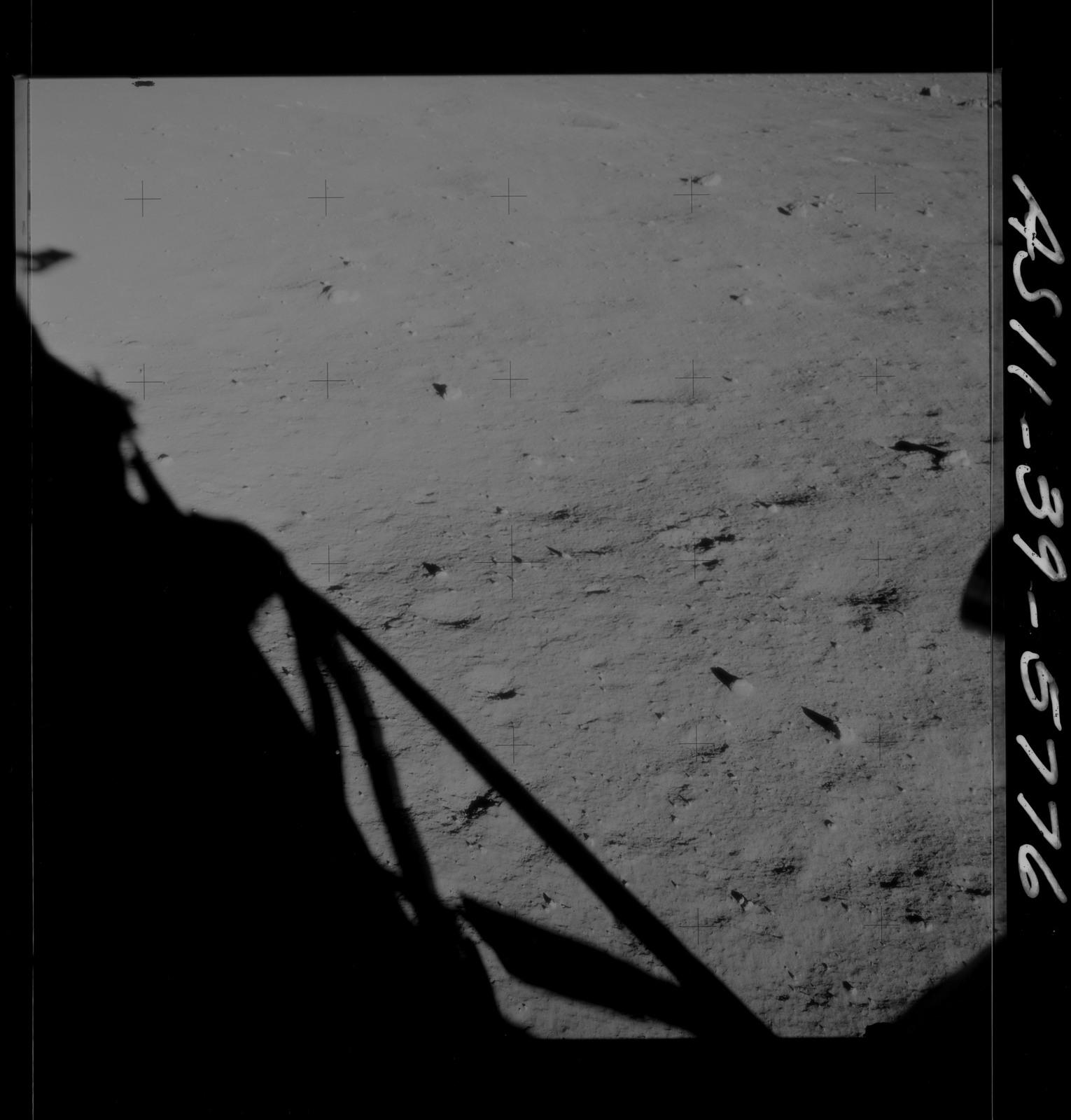 AS11-39-5776 - Apollo 11 - Apollo 11 Mission image - Shadow of Lunar Module on lunar surface