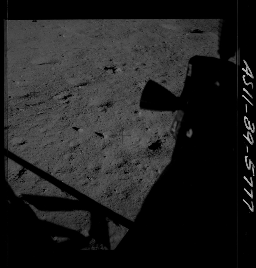 AS11-39-5777 - Apollo 11 - Apollo 11 Mission image - Shadow of LM and thruster on lunar surface