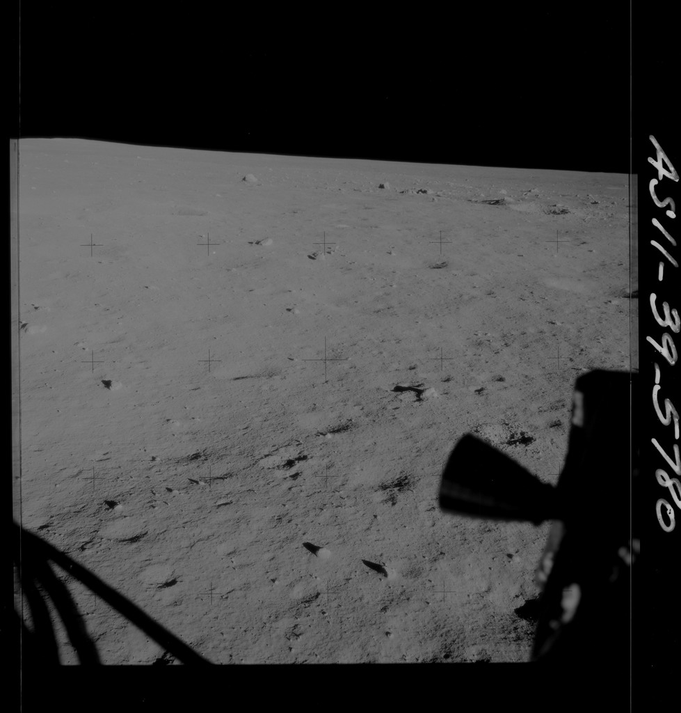 AS11-39-5780 - Apollo 11 - Apollo 11 Mission image - Shadow of LM and thruster on lunar surface