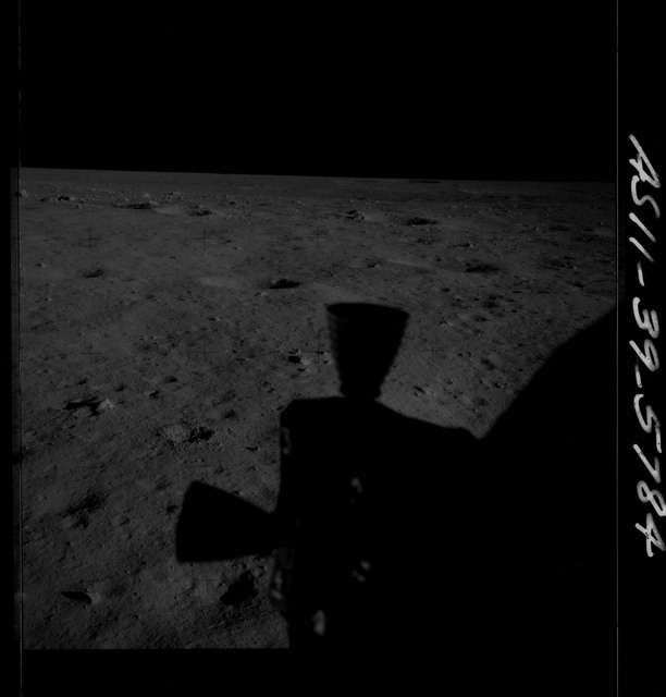 AS11-39-5784 - Apollo 11 - Apollo 11 Mission image - Shadow of LM thrusters on lunar surface