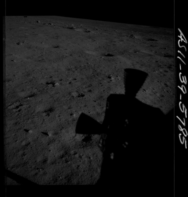 AS11-39-5785 - Apollo 11 - Apollo 11 Mission image - Shadow of LM thrusters on lunar surface