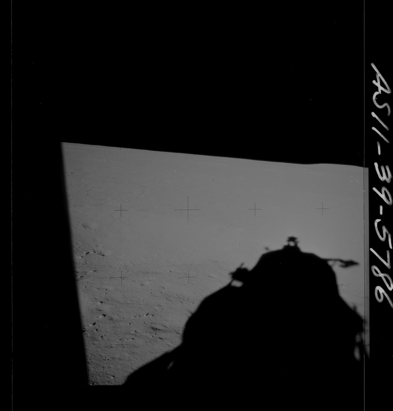 AS11-39-5786 - Apollo 11 - Apollo 11 Mission image - Shadow of Lunar Module on lunar surface